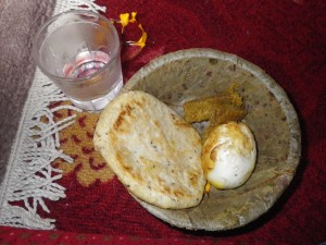 Raxsi, bara, meat and boiled then fried egg.